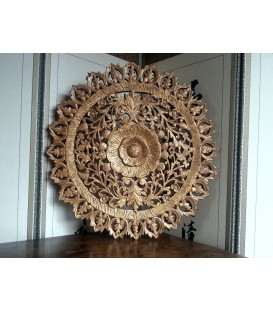 Richly carved wooden disc from Thailand